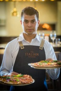 Italian Kitchen Chef With Pizza